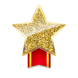 Golden star with gold sparkles and glitter on red ribbon Stock Images