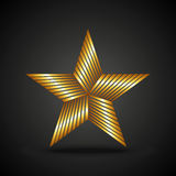 Golden star icon on dark background Royalty Free Stock Photo