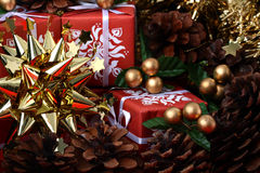 Golden star with red gift boxes and fir cones Royalty Free Stock Photography