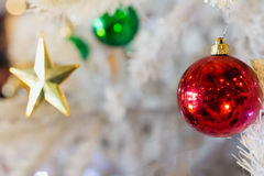 Golden star with red green ball and white Christmas tree backgro Stock Photography