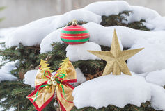 Golden star and ribbon christmas decoration. Stock Image