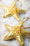 Golden star shape Christmas decorations Royalty Free Stock Photography