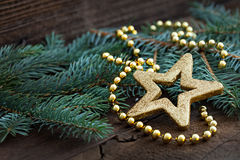Golden star shape on fir Royalty Free Stock Images