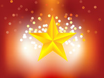 Golden star in shining background Stock Photo