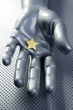 Golden star on silver futuristic hand Royalty Free Stock Image