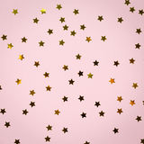Golden star sprinkles on pink. Festive holiday background. Celeb. Ration concept. Top view, flat lay. Square Stock Images