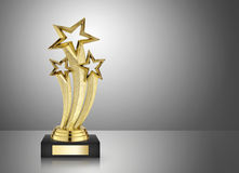 Golden star trophy. On gray background royalty free stock image