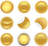 Golden starbursts set Royalty Free Stock Photo