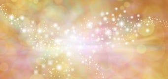 Golden starry glitter warm toned bokeh background banner Stock Photos