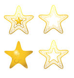 Golden stars. Four decorativ golden stars with ornament Stock Images