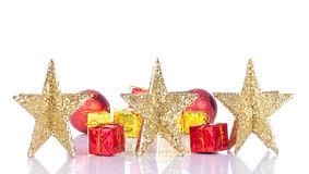 Golden stars. On white with red and gold gifts Royalty Free Stock Photography