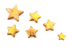 Golden stars. Glossy and isolated over white stock photo