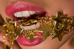 Golden stars. Lovely young girl with golden star-shaped necklace Stock Photo