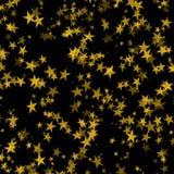 Golden stars. In black background stock photos