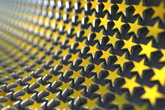 Golden stars. The golden stars align in curve with the shallow depth of field Royalty Free Stock Photos