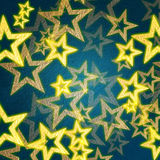 Golden stars in blue background Royalty Free Stock Photo