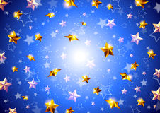 Golden stars on a blue background Stock Photo