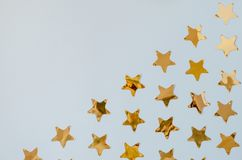 Golden stars on a blue background. royalty free stock images