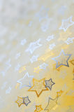 Golden  stars on cloth  background Stock Photography