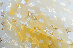 Golden  stars on cloth  background Royalty Free Stock Image