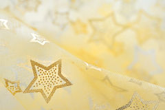 Golden  stars on cloth  background Royalty Free Stock Images