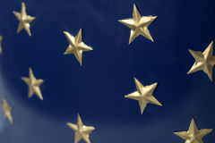 Golden stars on dark blue background. Festive background. Selective focus royalty free stock photography