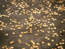 Golden stars on dark brown background Stock Photography