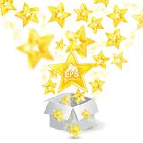 Golden stars with depth of field effect flying from open gift box. Isolated on white Stock Photos