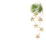 Golden stars evergreen branches Christmas ornaments minimal. Golden stars with evergreen branches. Christmas ornaments on white background. Minimal flat lay stock photos