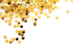 Golden stars in the form of confetti. On white Stock Image