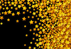 Golden stars glitter scattered on black in celebration card Royalty Free Stock Images