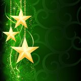 Golden stars on green background Stock Photography