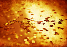 Golden stars grunge background Stock Photography