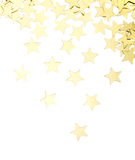 Golden stars isolated. Scattered golden stars decorations isolated on white background royalty free stock photo