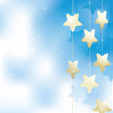 Golden stars on a light blue background Royalty Free Stock Photo