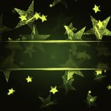 Golden stars over green christmas background. Abstract golden stars over dark green christmas background with text space Royalty Free Stock Photos