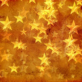 Golden stars over old paper Stock Image
