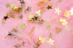 Golden stars in a pink plumage Stock Images