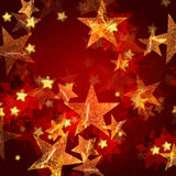 Golden stars in red Stock Image