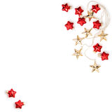 Golden stars red baubles Christmas ornaments flat lay Royalty Free Stock Photo