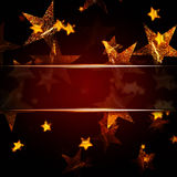 Golden stars, red christmas background Stock Photos