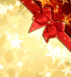 Golden stars with red ribbon Royalty Free Stock Photography