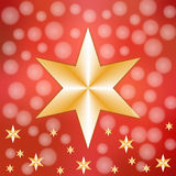 Golden stars on red snowy background. One large golden star in the middle and many small ones in the lower part on a red background with snow and a copyspace in Stock Image