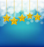 Golden stars on ropes Royalty Free Stock Photography