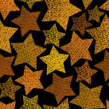 Golden stars seamless pattern, vector repeating background with Stock Images