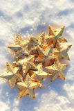 Golden Stars in the Snow Stock Photos