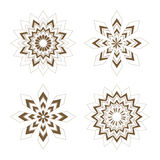 Golden stars - Snowflakes. A vector illustration of four different golden stars, snowflakes Royalty Free Stock Photography