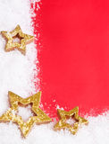Golden stars on snowy background Royalty Free Stock Photography