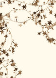Golden stars and spangles as holiday background. In Sepia toned. Royalty Free Stock Photo