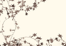 Golden stars and spangles as holiday background. In Sepia toned. Stock Photo